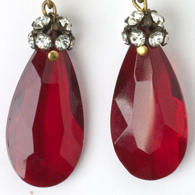 Close-up view of glass teardrops with diamante crowns