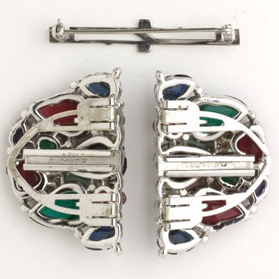 Pair of dress clips with brooch mechanism