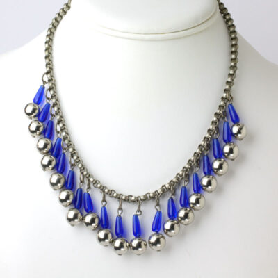 Fringe statement necklace w/blue glass tubes & chrome balls