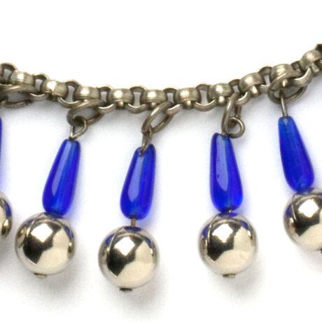 Close-up view of glass tubes & chrome balls