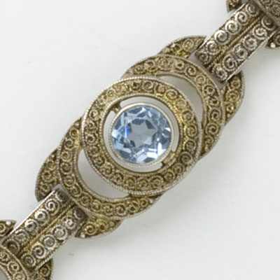 Close-up view of filigree link with aquamarine