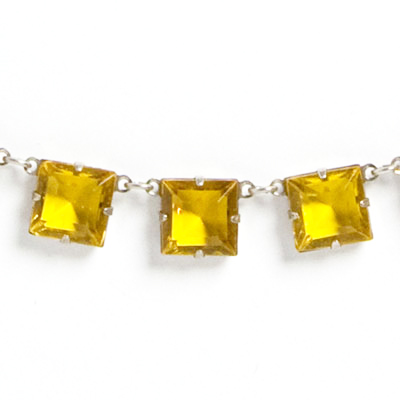 Close-up view of faceted citrine-glass stones