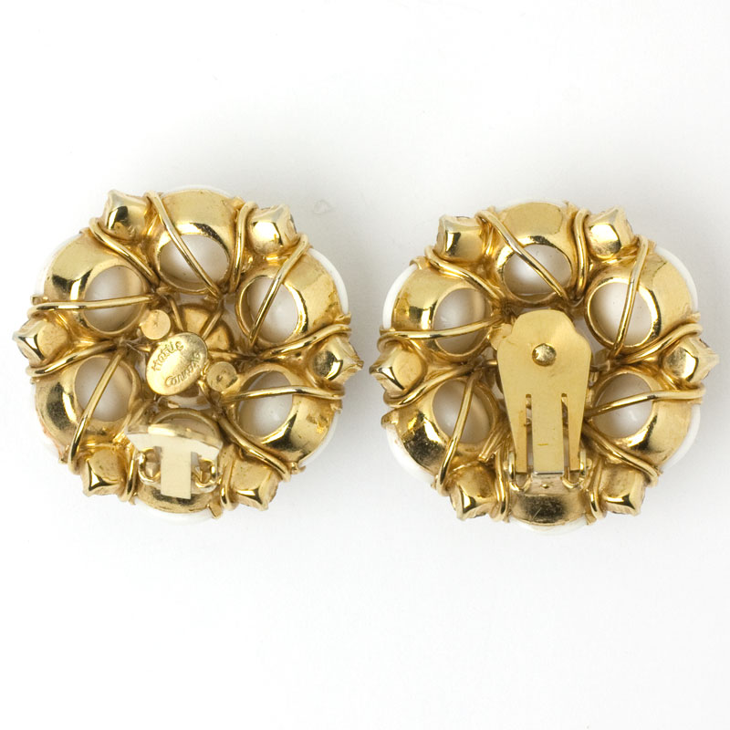 Earring backs, showing complex construction