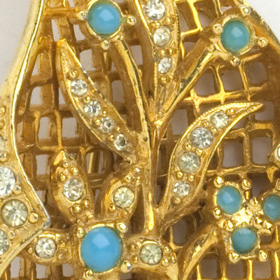 Close-up view of layered, jeweled brooch