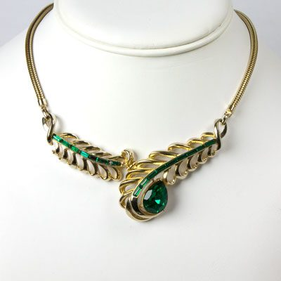 Corocraft necklace in gold-tone with emeralds