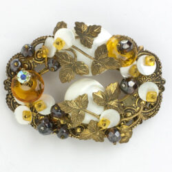 Oval brooch w/layers of stones & leaves