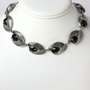 Schiaparelli necklace of onyx stones in silver leaves