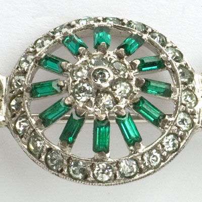 Centerpiece of Otis emerald & diamante brooch