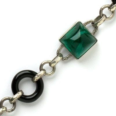 Close-up view of sugar-loaf emeralds & onyx rings