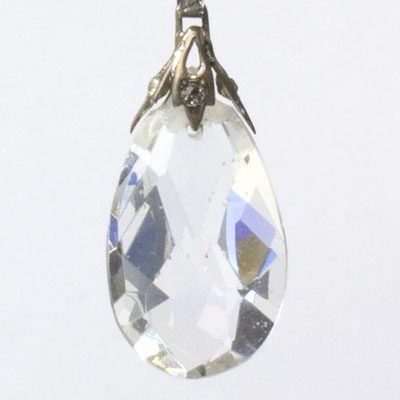 Close-up view of teardrop-shaped faceted crystal