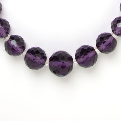 Close-up view of faceted beads & disk spacers