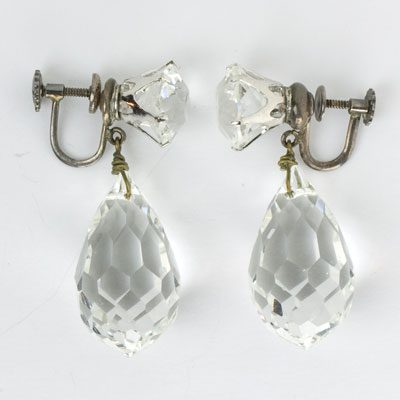 Another view of earrings, showing bold stones