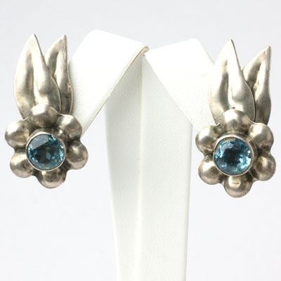 Flower ear clips with leaf accents