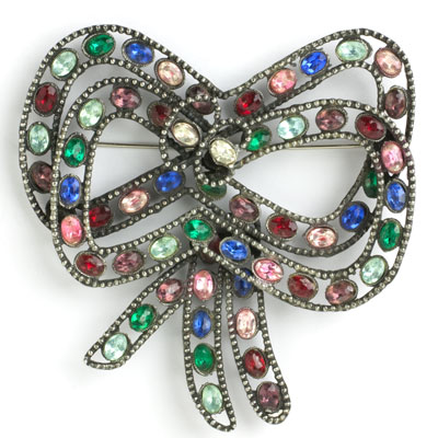 Vintage bow brooch with gemstones, by Reinad
