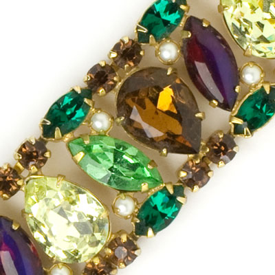 Close-up view of rich gemstones & pearls
