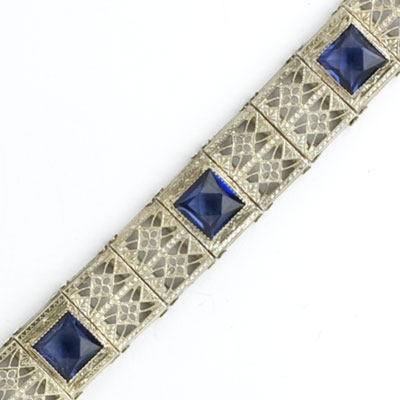 Close-up view of faux sapphire set in sterling