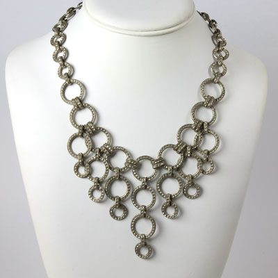 Art Deco bib necklace with silver rings