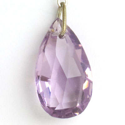 Close-up view of faceted glass teardrop