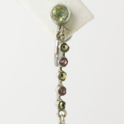 Close-up view of earring top