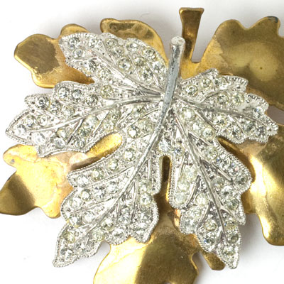 Close-up view of maple leaf brooch