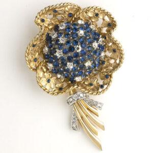 Boucher flower brooch in gold w/sapphires & diamanté