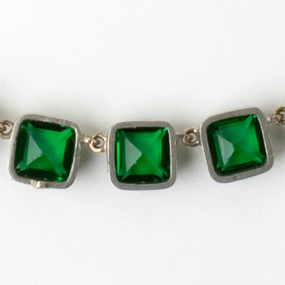 Close-up view of emerald stones in frames