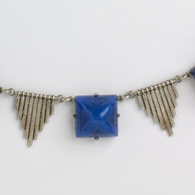 Close-up view of lapis-glass stone & silver-tone triangles