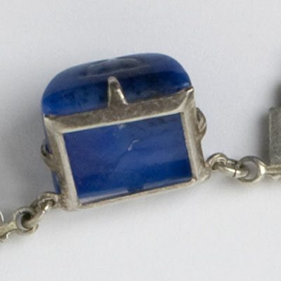 Side view of molded-lapis-glass stone