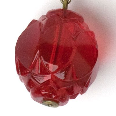 Close-up view of ruby glass bead