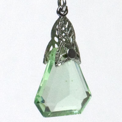 Close-up view of faceted stone capped with filigree