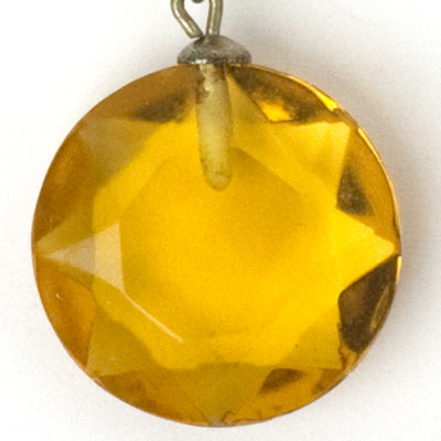 Close-up view of round, faceted drop