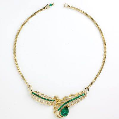 Front of snake chain with emerald & gold center