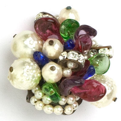 Close-up view of pearls, gemstone leaves & rondelles