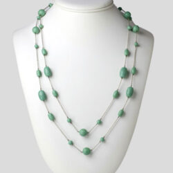 Long turquoise bead necklace on silver-tone chain