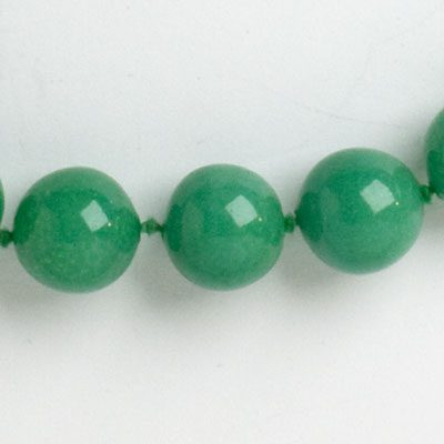 Close-up view of jade glass beads