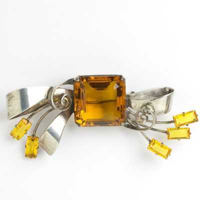 Citrine pin in sterling bow setting