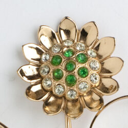 Flower set with emerald-glass stones & diamante