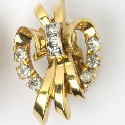 Close-up view of gold-plated earring