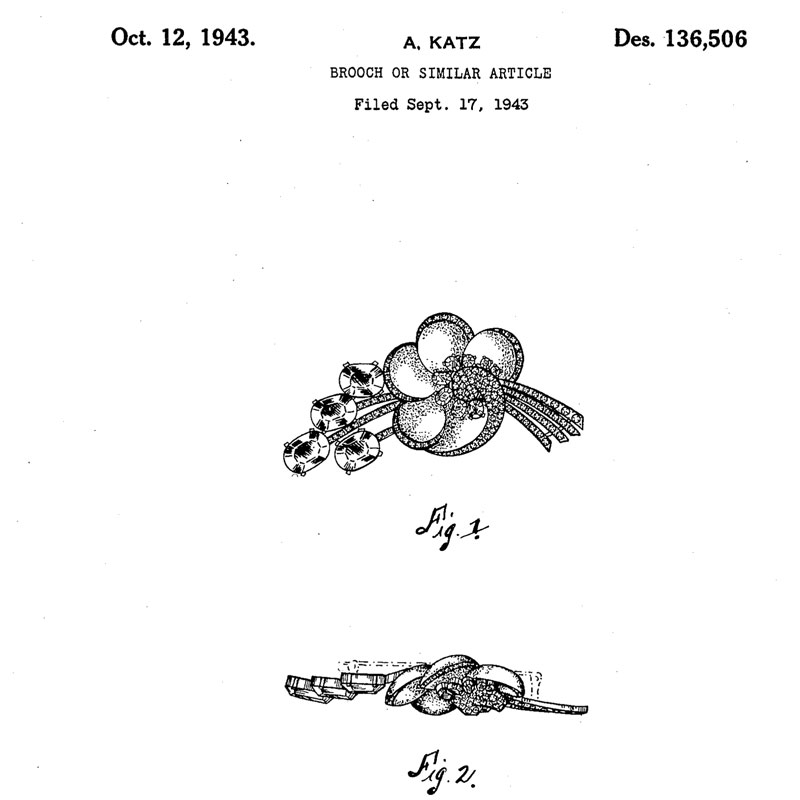 Design patent for Corocraft brooch