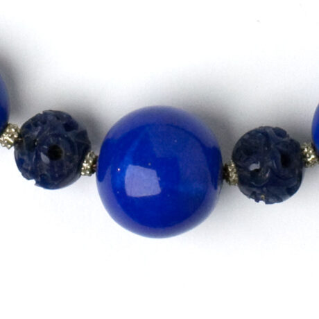 Close-up view of lapis and celluloid beads