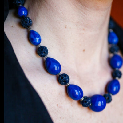 Carrie wearing this lapis bead necklace