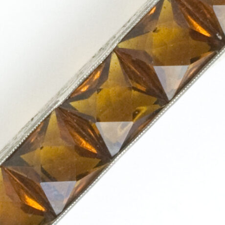 Close-up view of faceted channel-set stones
