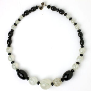 Full view of black-and-white beaded necklace