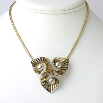 Floral brooch worn as pendant