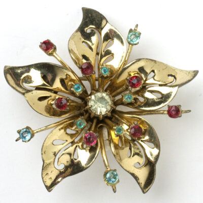 Vintage flower brooch by Coro with diamanté, aqua and ruby set in gold-plated sterling