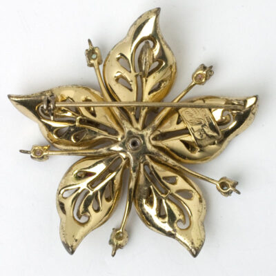 Back of flower brooch showing pendant loop