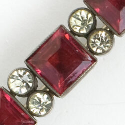 Close-up view of faceted stones with pairs of diamante