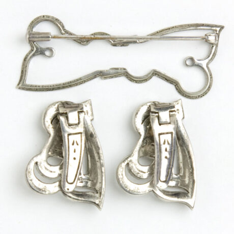 Dress clips and their brooch mechanism