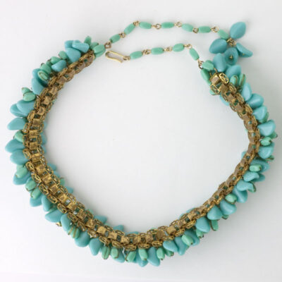 View of turquoise beaded necklace showing brass link base