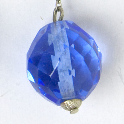 Close-up of faceted blue glass bead